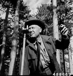 Photograph of District Ranger Harley Hamm Using a Surveying Compass